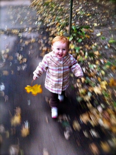 Dee running with a fall leaf