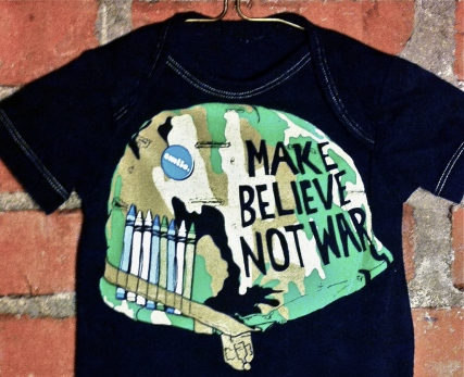 Tumblewee's Make Believe not War onesie closeup